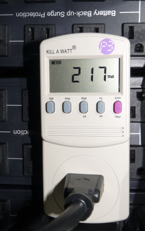 kill-a-watt Dell PowerEdge 2650 measuring 217 watts electical usage (cropped image)